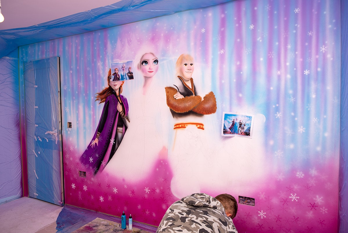 Frozen movie characters during painting on the wall