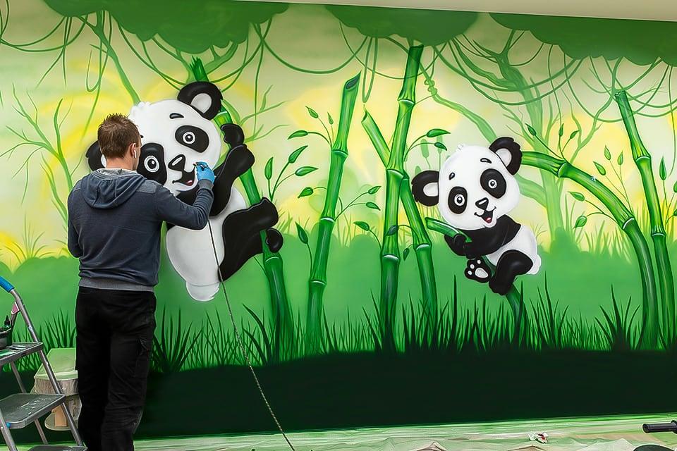 mural artist painting panda mural FB